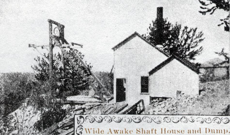 This rather crude looking image shows a small mine operation on Raven Hill. There is a small hoist house and a small head frame appears in front of the house, out unto a dump on the hill side. A small attached shed is seen on this side of the hoist house, and there is a smokestack sticking up from the house, saying this was a coal driven hoist.