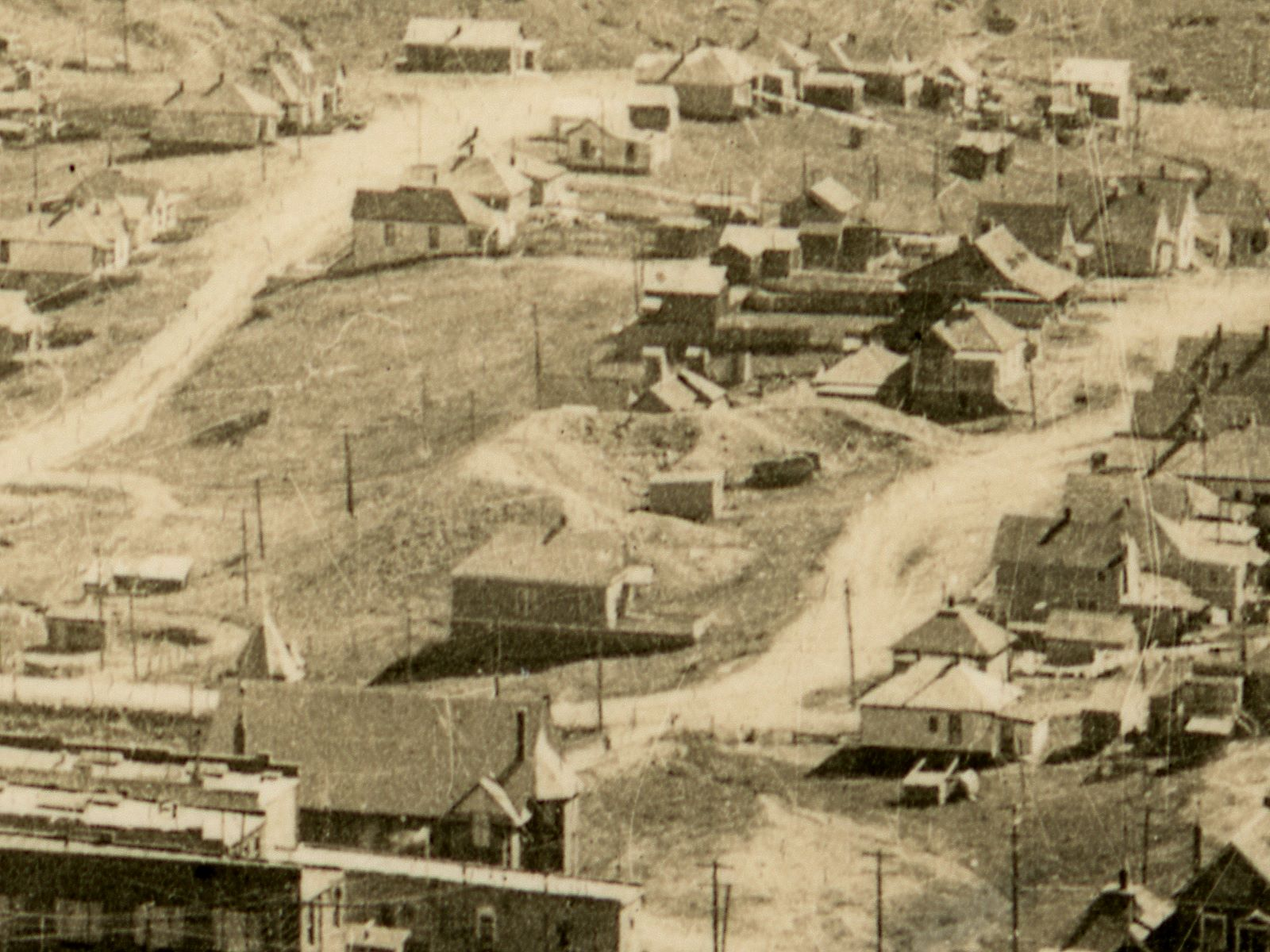 About center of this view, is the dump ground and former location of the St. Patrick mine in Victor, Colorado, located along south fourth street (on right-hand side), between the Spicer and Lee Avenues.    This view is cropped from a postcard by Bill Lehr of Victor from Battle Mountain up near the Ajax mine. Photograph date is possible late 1930's or early 1940's. The postcard has a EKC stamp box on the backside, and Google gives info that this is from the 1939-1950 timespan, and as there are still rails seen, with railroad cars, I assume M.T. is still running, making this also fit the late 1930's and very early 1940's timeframe.