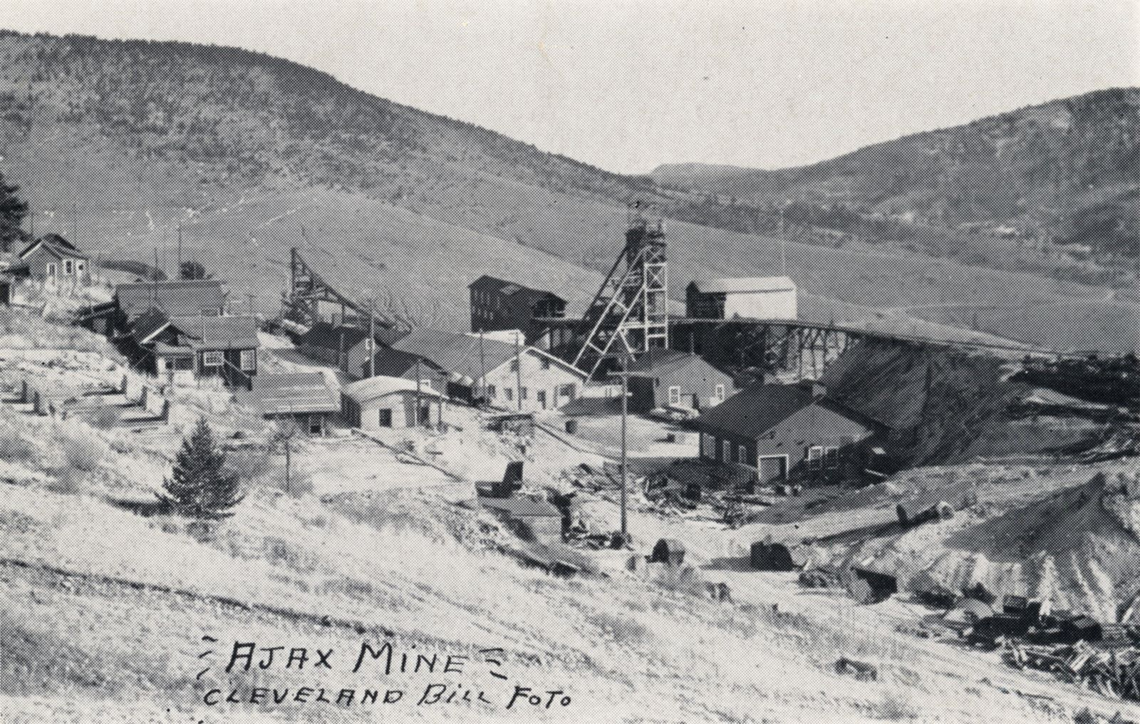 Actually, quite a nice view of the Ajax Mine area, I also have this an as photo from a Newspaper Archive, said to been photographed around January 1942. Not much to pick put in this view from the golden heydays when the massive mine structures dotted this area, and the railroads run in this area.    I think about middle top/down on the left-hand side is the foundation for the Clancy/Ajax Mill, while the Ajax Headframe is easy enough to pick out just right of the center of the view.
