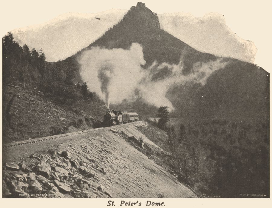View a train climbing the grade with St. Peter's Dome in background, photo by William Henry Jackson