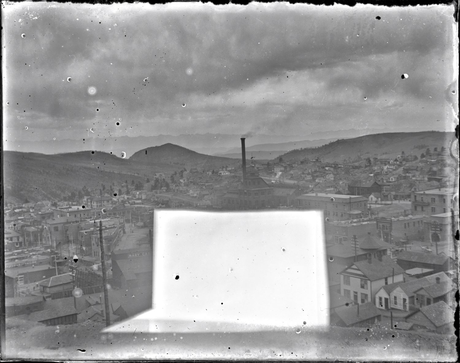 Sadly, this image is pretty messed up by that large whitish block showing up on the glass plate negative. Add the fact it is really not that sharp either, and blurs a little on the edges, and it folds itself nicely into most other images in my collection, close but not the best of views, like most of the images I have! * Around center of the view is the familiar look of the Gold Coin structures, looking at the north and east walls. * Near lower left is the F. & C.C. depot, the western part of it obscured by the crib-wall of the Mary Cashen mine. The Ore-house is partly hidden under the damaged part, same with the head frame, and any other possible good things. * The M.T. depot is seen near the lower right corner. * Near the right-hand side, about 2/5 down from the top, is the head frame and hoist house of the Golconda mine, sadly I was not able to get a sharp scan so there is no reason to try get a closer look as it really is not much to look at, not sharp at all in a higher resolution scan.