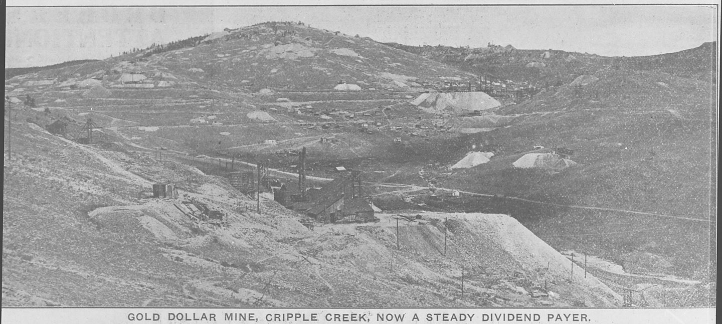 This view looking north east from a place just south and west for the surface structures of the Gold Dollar Mine on Beacon Hill, also shows the valley Arequa was in, with Guyot Hill prominent in the background and several other mines seen. But of course, I wish this was a true photograph, because then I would most likely been able to better get a view of the finer details lost in this view here. There are several things of interest, from a better look at the Gold Dollar in the foreground with its dump, to the Elkton Mine seen about 1/3 from top and about 1/3 in from right-hand side with its huge dumps, to the railroad lines running passed it, or many of the other mines hinted in this view. But sadly, this is what I have, where someone took a photo of a printed source somewhere, and I ended up getting my hand on that negative of that photo years later.