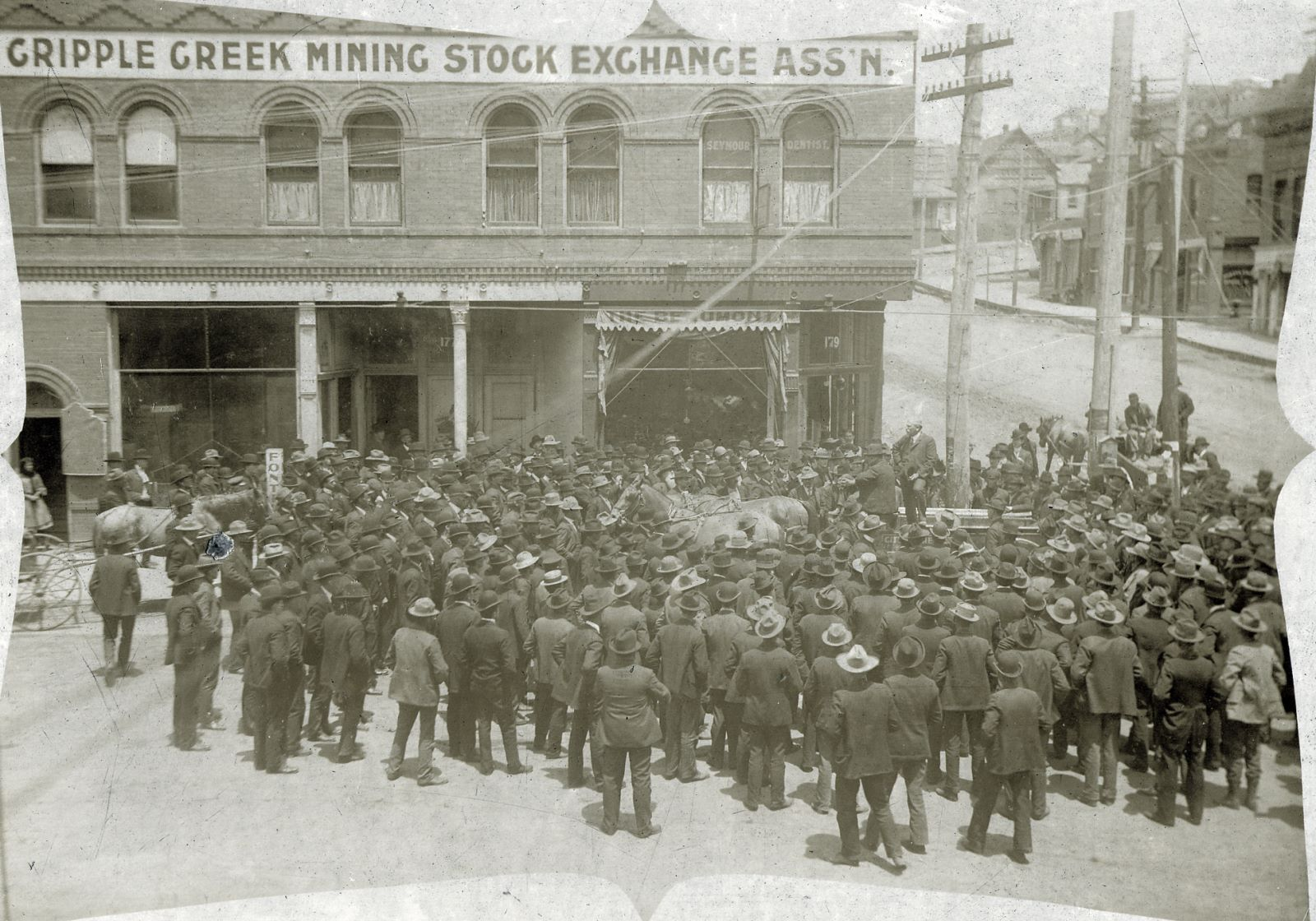 A View of a Large Crowd of People Outside the Cripple Creek Stock Exchange Building in Cripple Creek