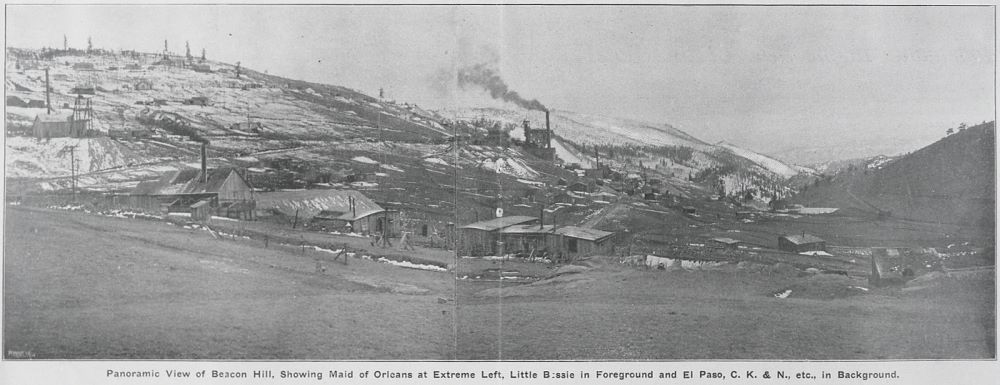 This not so great view shows many of the mines on Beacon Hill. Extreme left is the Maid of Orleans, Little Bessie is in the foreground and the El Paso, C. K. & N., etc., is in the background middle. Far down valley at right hand side is part of the F. & C.C. switchback branch line down to the Henry Adney & Old Gold mines.