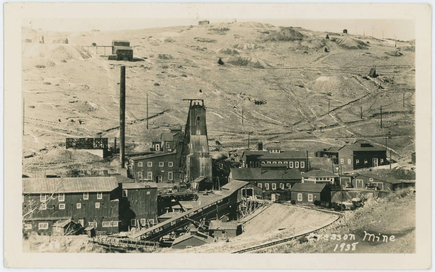 This is the 8th postcard I've seen (as of July 21, 2018) using the base image this is from, this is one of those editions where the text 1938 appears under the words 'Cresson Mine' in lower right. Raven Hill is in the background and sorry, no, I've yet to figure out what mine has that Ore-House seen near upper left, seen just above top of the Cresson Smokestack.
